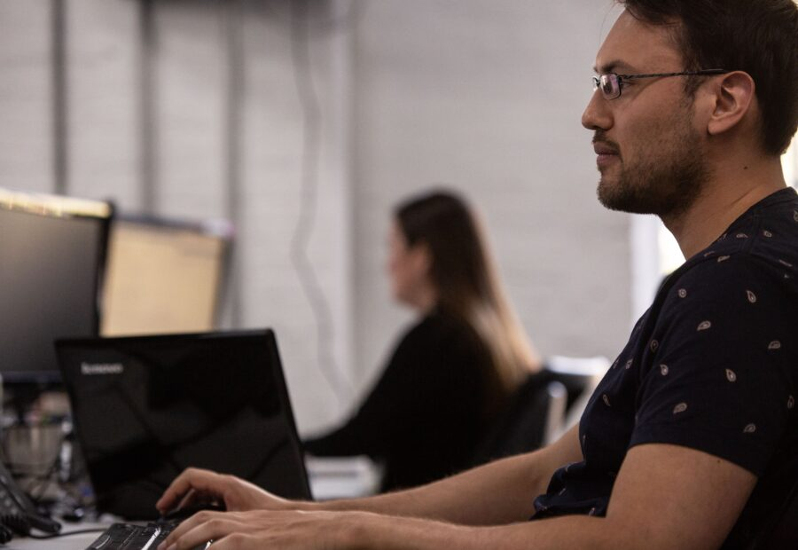 Man Looking Stoic at Desk